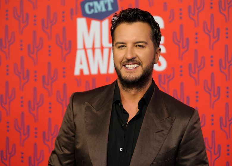 FILE – In this June 5, 2019 file photo, Luke Bryan arrives at the CMT Music Awards at the Bridgestone Arena in Nashville, Tenn. A Tennessee wildlife official says a nonnative red stag that was shot and killed last week belonged to the country music singer. Wildlife Resources Agency spokesman Barry Cross told The Tennessean investigators think the deer was shot from the road onto Bryan's private property near Columbia between Wednesday, Dec. 4 and Friday, Dec. 6. (AP Photo/Sanford Myers, File)