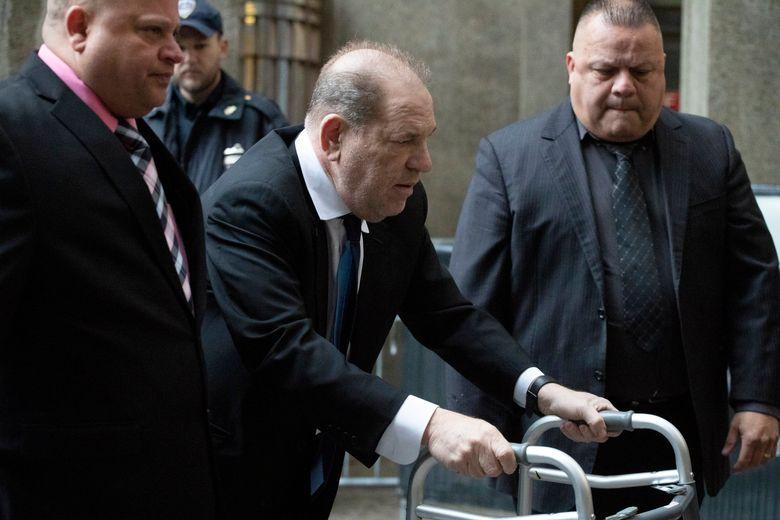 Harvey Weinstein, center, arrives for a court hearing, on Wednesday in New York. (AP Photo / Mark Lennihan)
