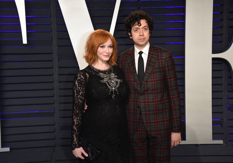 FILE – In this Feb. 24, 2019 file photo, Christina Hendricks, left, and Geoffrey Arend arrive at the Vanity Fair Oscar Party in Beverly Hills, Calif. Hendricks filed for divorce Friday, Dec. 13,  from her husband of 10 years, actor Geoffrey Arend.  Hendricks filed the marriage dissolution documents in Los Angeles Superior Court, citing irreconcilable differences.   (Photo by Evan Agostini/Invision/AP, File)