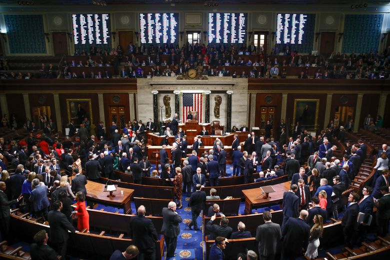 House members vote as House Speaker Nancy Pelosi of Calif., center, stands on the dais, during a vote on article II of impeachment against President Donald Trump, Wednesday, Dec. 18, 2019, on Capitol Hill in Washington. (AP Photo/Patrick Semansky)