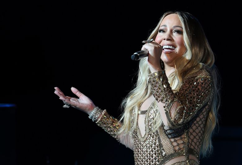 """FILE – In this Oct. 20, 2019 file photo Mariah Carey performs during a concert celebrating Dubai Expo 2020 One Year to Go in Dubai, United Arab Emirates. Christmas has come early for Carey: the pop star's original holiday classic, """"All I Want for Christmas Is You,"""" has reached the No. 1 spot on the Billboard Hot 100 chart 25 years after its release. Billboard announced that the song topped this week's chart, giving Carey her 19th No. 1 of her career.  (AP Photo/Kamran Jebreili, File)"""