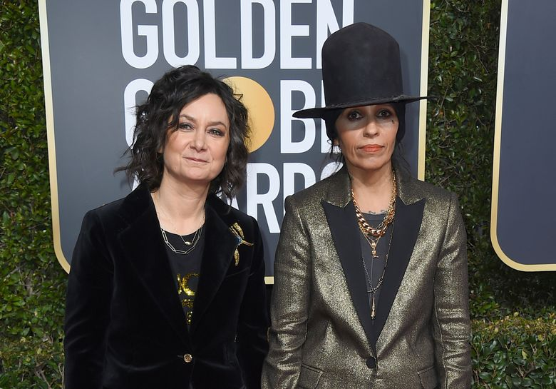 FILE – In this Jan. 6, 2019, file photo, Sara Gilbert, left, and Linda Perry arrive at the 76th annual Golden Globe Awards at the Beverly Hilton Hotel in Beverly Hills, Calif. Gilbert filed for legal separation from her wife of five years, singer and songwriter Perry on Friday, Dec. 27. (Photo by Jordan Strauss/Invision/AP, File)