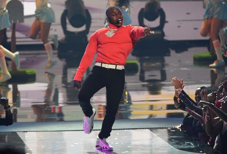 """FILE – In this June 23, 2019 file photo, DaBaby performs """"Sugar"""" at the BET Awards at the Microsoft Theater in Los Angeles. DaBaby, Guns N' Roses, Maroon 5 and DJ Khaled will perform at the second annual Bud Light Super Bowl Music Fest, to take place Jan. 30 through Feb. 1 at AmericanAirlines Arena in Miami.  (Photo by Chris Pizzello/Invision/AP, File)"""
