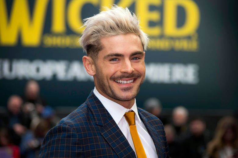 """FILE – In this Wednesday, April 24, 2019, file photo, actor Zac Efron poses for photographers upon arrival at a premiere in London. On his Twitter and Instagram accounts Sunday, Dec. 29, 2019, Efron said he has has """"bounced back"""" after an illness while filming a show in Papua New Guinea. (Photo by Joel C Ryan/Invision/AP, File)"""