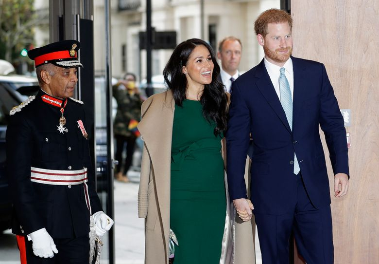"""FILE – In this Tuesday, Oct. 15, 2019 file photo, Britain's Prince Harry and Meghan, Duchess of Sussex arrive to attend the WellChild Awards Ceremony in London. Prince Harry's office has confirmed on Friday, Dec. 20 that he and his family will be spending """"private time"""" in Canada over the Christmas holidays. That means Harry, his wife Meghan and their seven-month-old son Archie will miss Queen Elizabeth II's traditional Christmas gathering at her Sandringham estate, which typically includes the exchange of gifts on Christmas Eve and a church service and fancy lunch on Christmas Day.  (AP Photo/Kirsty Wigglesworth, file)"""