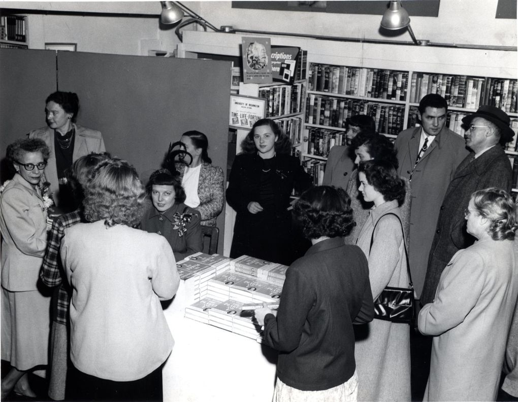 """Northwest author Betty MacDonald signs copies of her memoir """"The Plague and I"""" at University Book Store in 1948. (Courtesy of University Book Store)"""