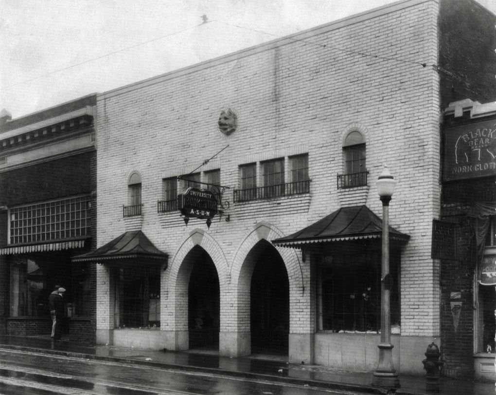 University Book Store moved from an on-campus location to 4326 University Way N.E. in 1925. The building featured a Gothic facade designed by architects Charles Bebb and Carl Gould. Note the carved Husky head up top. (Courtesy of University Book Store)