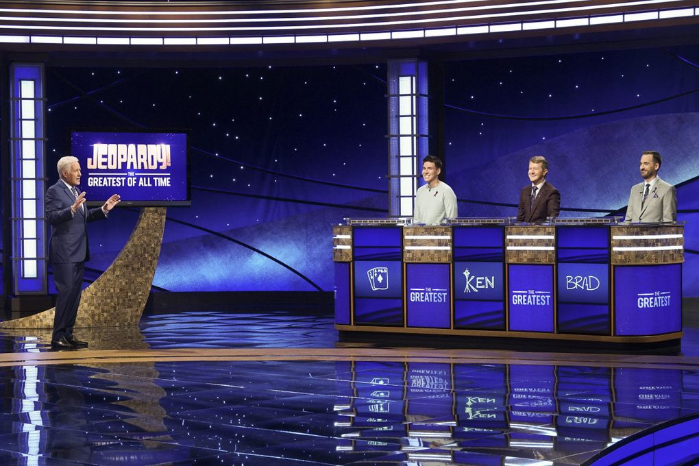 """""""Jeopardy!"""" host Alex Trebek, left, with contestants James Holzhauer, Ken Jennings and Brad Rutter on the set of """"Jeopardy! The Greatest of All Time."""" (Eric McCandless / ABC)"""