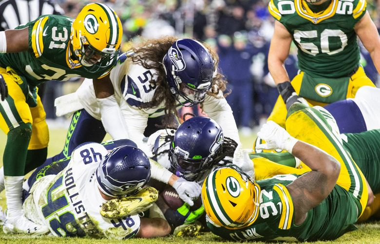 Seattle Seahawks running back Marshawn Lynch drives into the end zone for a touchdown in the third quarter as the Green Bay Packers play the Seattle Seahawks at Lambeau Field in Green Bay Wisconsin on January 12, 2020.    (Mike Siegel / The Seattle Times)
