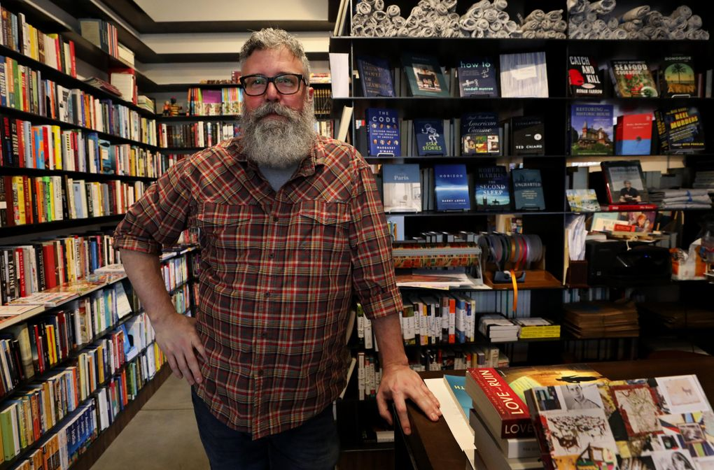 James Crossley is the manager of Madison Books, the neighborhood's small independent store that's been open for a little more than a year. (Alan Berner / The Seattle Times)