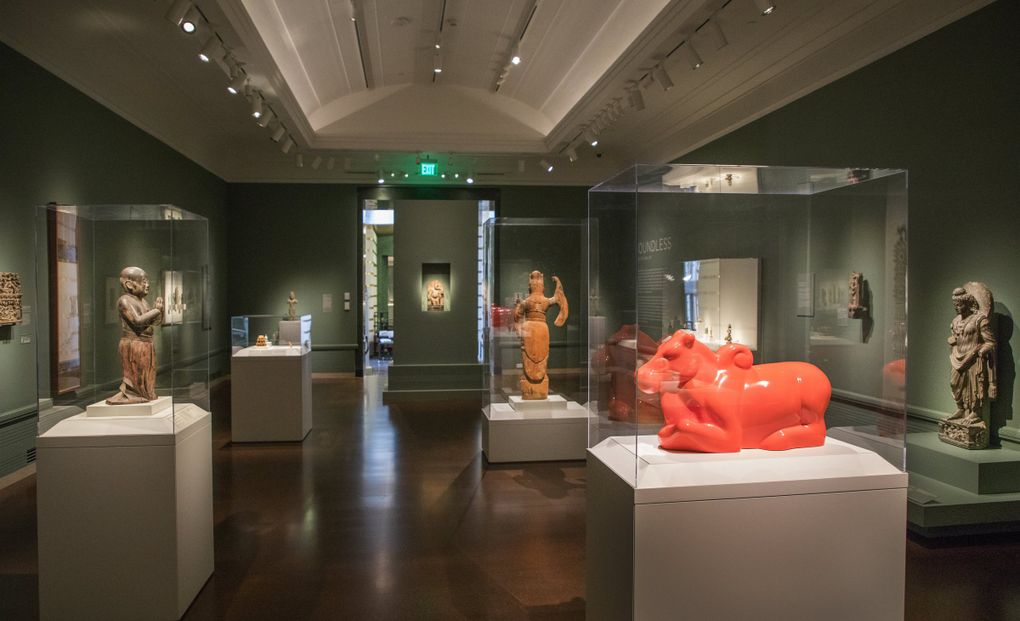 """The orange, extruded-fiberglass """"Nandi"""" brightly punctuates Seattle Asian Art Museum's """"Spiritual Journeys"""" gallery, which is full of stone, wood and other visually muted materials. (Steve Ringman / The Seattle Times)"""