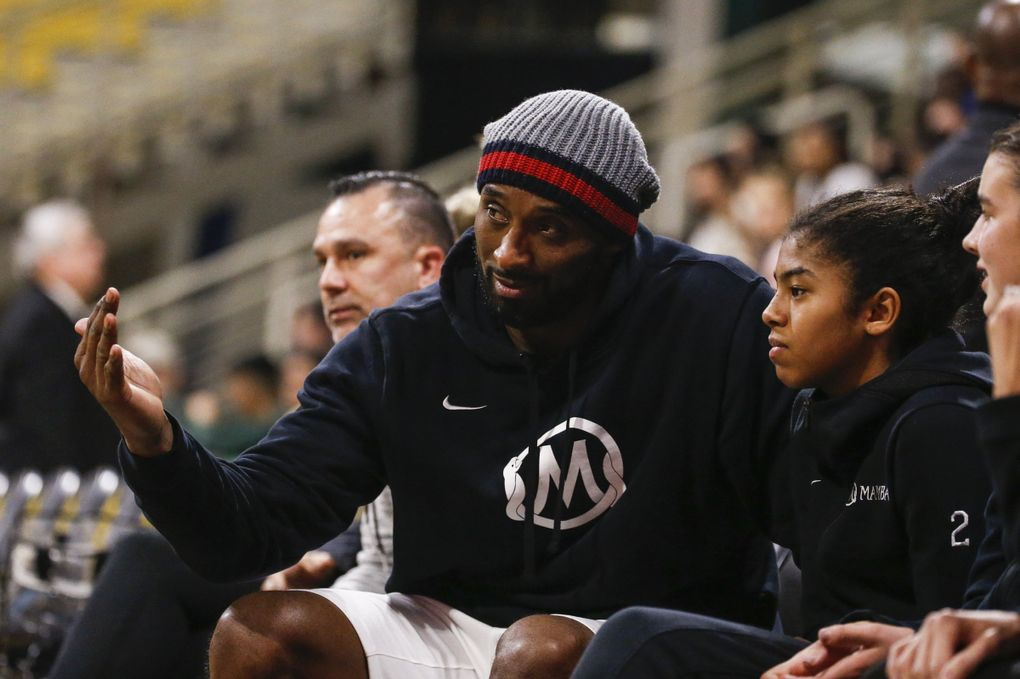 Former NBA star Kobe Bryant and his daughter Gianna attends an NCAA women's college basketball game between Long Beach State and Oregon, Saturday, Dec. 14, 2019 in Long Beach, Calif.  (Ringo H.W. Chiu / AP)