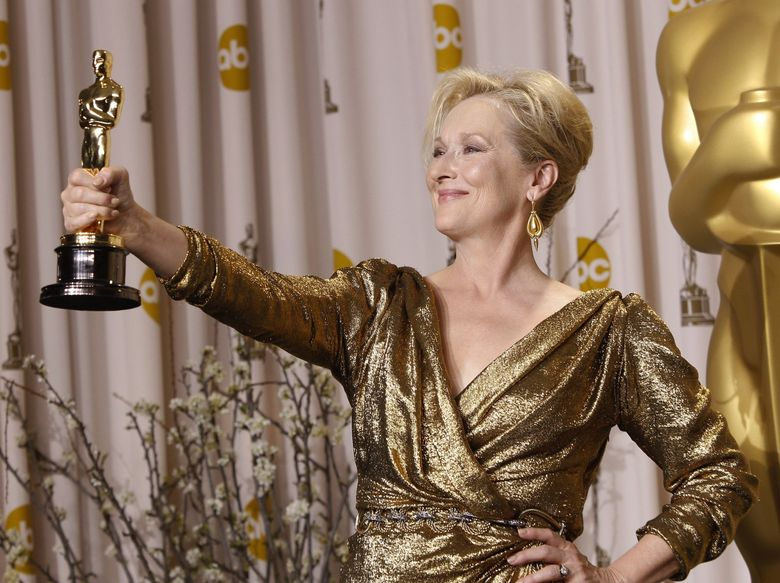 """Meryl Streep lightened the mood when she accepted her third Oscar in 2012 for """"The Iron Lady."""" """"I had this feeling I could hear half of America going, """"Oh no! Oh, c'mon why? Her? Again?,"""" she said. (Joel Ryan / The Associated Press)"""