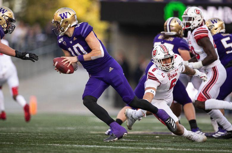 Utah's Bradlee Anae tries to tackle UW's Jacob Eason in November. (Dean Rutz / The Seattle Times)