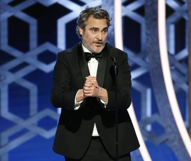 """This image released by NBC shows Joaquin Phoenix accepting the award for best actor in a motion picture drama for his role in """"Joker"""" at the 77th Annual Golden Globe Awards at the Beverly Hilton Hotel in Beverly Hills, Calif., on Sunday, Jan. 5, 2020. (Paul Drinkwater/NBC via AP) NYET882 NYET882 (Paul Drinkwater / The Associated Press)"""