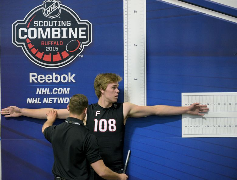 FILE – In this June 6, 2015, file photo, Connor McDavid participates in the wingspan measurement during the NHL Scouting Combine in Buffalo, N.Y.  The NHL's top prospects will continue making their pre-draft stop in Buffalo for at least another three years, The league on Monday, Jan. 13, 2020, announced it has extended its agreement to hold its annual scouting combine in Buffalo at the Sabres downtown practice facility, LECOM Harborcenter, through 2022. (AP Photo/Gary Wiepert, File)