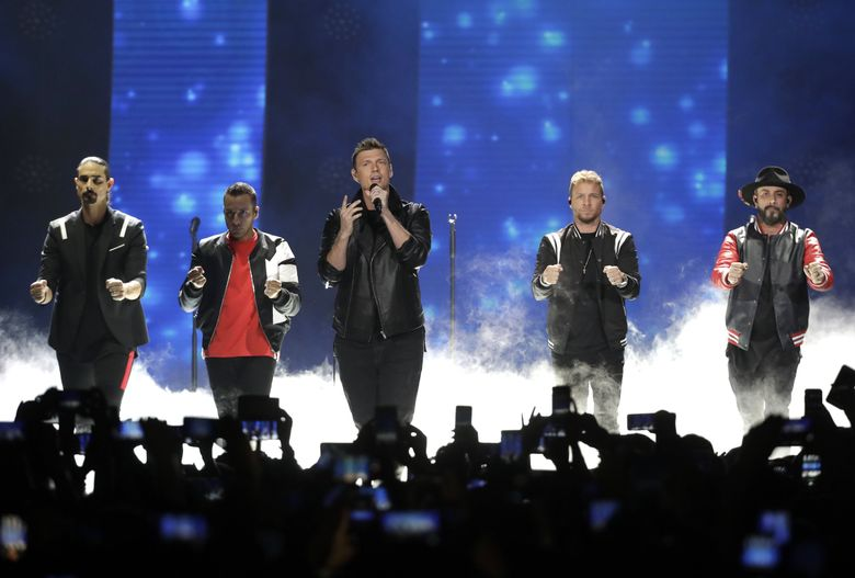 """Kevin Richardson, Howie Dorough, Nick Carter, Brian Littrell, and AJ McLean of Backstreet Boys, perform """"Don't go Breaking My Heart"""" at the CMT Music Awards at the Bridgestone Arena in Nashville, Tenn., in 2018. (AP Photo/Mark Humphrey, File)"""