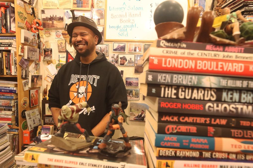At BLMF bookstore in Pike Place Market, J.B. Johnson is the owner. Ask nicely and you'll get the NSFW backstory behind the store's name. (Greg Gilbert / The Seattle Times)