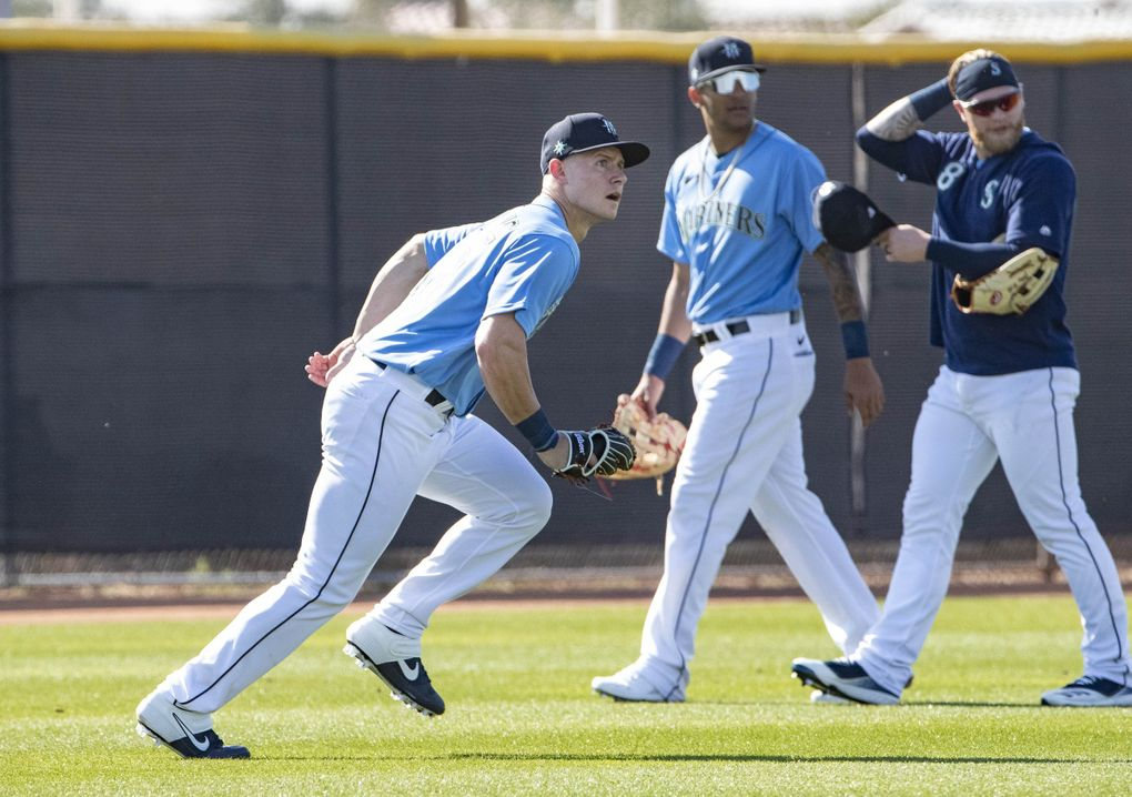 Outfielder Jarred Kelenic fields balls Tuesday. (Dean Rutz / The Seattle Times)
