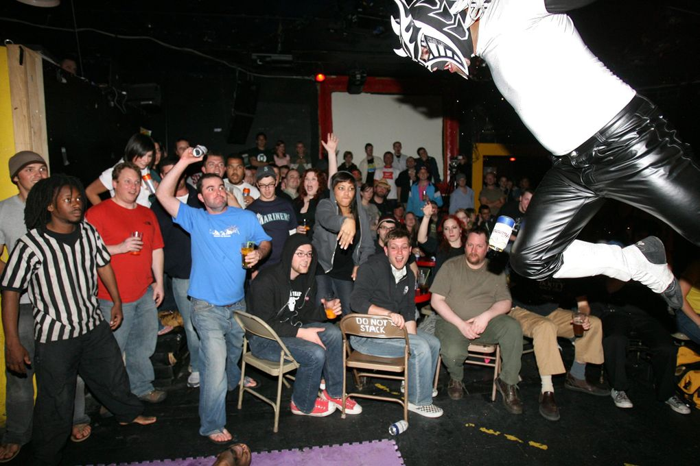 In a semi-pro wrestling match at Re-bar in 2007, Eric Hendrickson, aka Histeria, takes flight as he sails down to the floor, where his opponent is waiting for his body blow. (Steve Ringman / The Seattle Times)