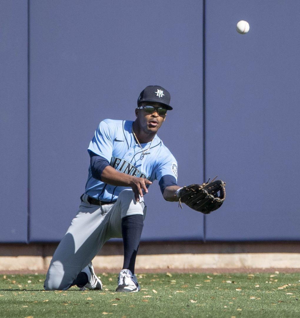 Seattle center fielder Mallex Smith makes a quick adjustment for the fly ball off the bat of Milwaukee's Manny Pina. (Dean Rutz / The Seattle Times)