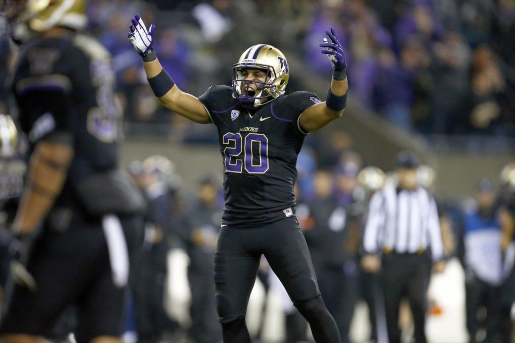 Washington safety Justin Glenn celebrates after intercepting a pass by Oregon State quarterback Sean Mannion in the first half at CenturyLink Field on Saturday, October 27, 2012, in Seattle, Wash.  (John Lok / The Seattle Times)