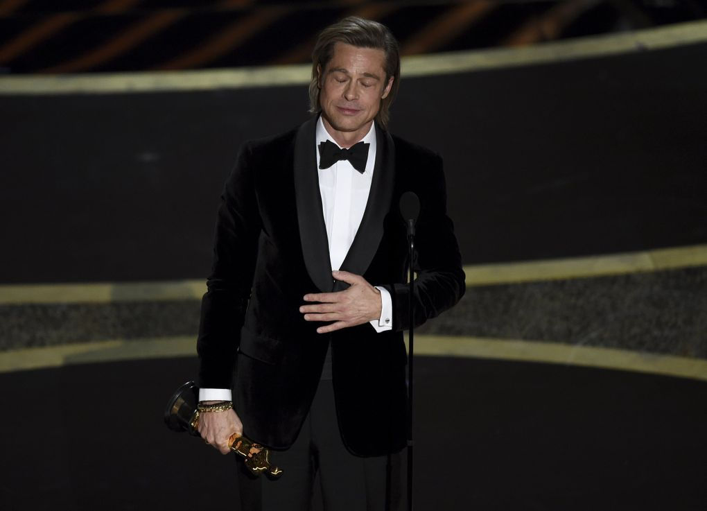 """Brad Pitt accepts the award for best performance by an actor in a supporting role for """"Once Upon a Time in Hollywood"""" at the Oscars on Sunday, Feb. 9, 2020, at the Dolby Theatre in Los Angeles. (AP Photo/Chris Pizzello) CADC188 CADC188 (Chris Pizzello / Chris Pizzello/Invision/AP)"""