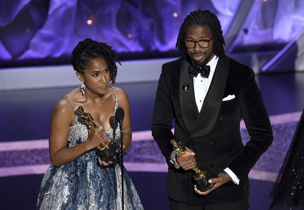 """Karen Rupert Toliver, left, and Matthew A. Cherry accept the award for best animated short film for """"Hair Love"""" at the Oscars on Sunday, Feb. 9, 2020, at the Dolby Theatre in Los Angeles. (AP Photo/Chris Pizzello) CADC207 CADC207 (Chris Pizzello / Chris Pizzello/Invision/AP)"""