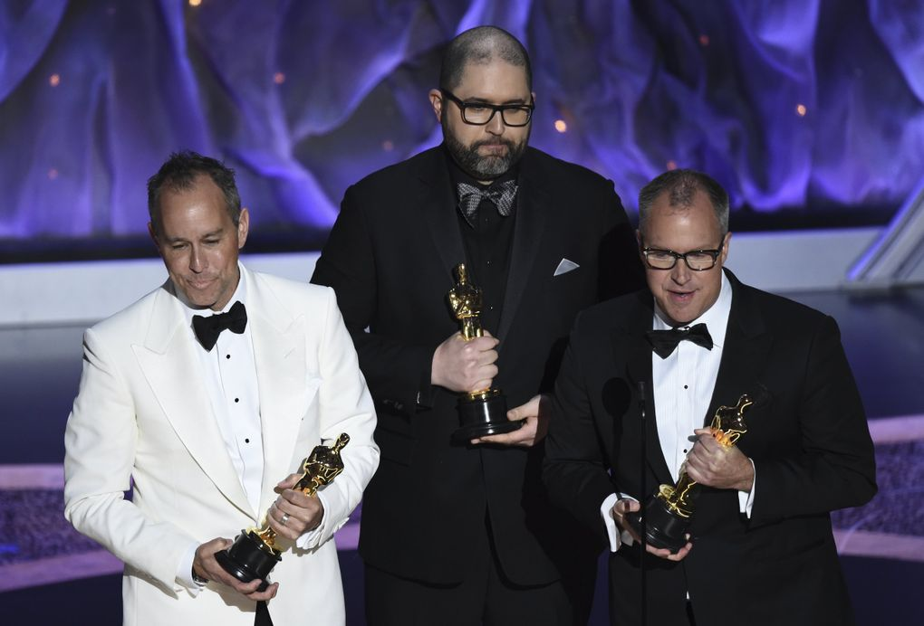 """Jonas Rivera, from left, Josh Cooley and Mark Nielsen accept the award for best animated feature film for """"Toy Story 4"""" at the Oscars on Sunday, Feb. 9, 2020, at the Dolby Theatre in Los Angeles. (AP Photo/Chris Pizzello) CADC205 CADC205 (Chris Pizzello / Chris Pizzello/Invision/AP)"""