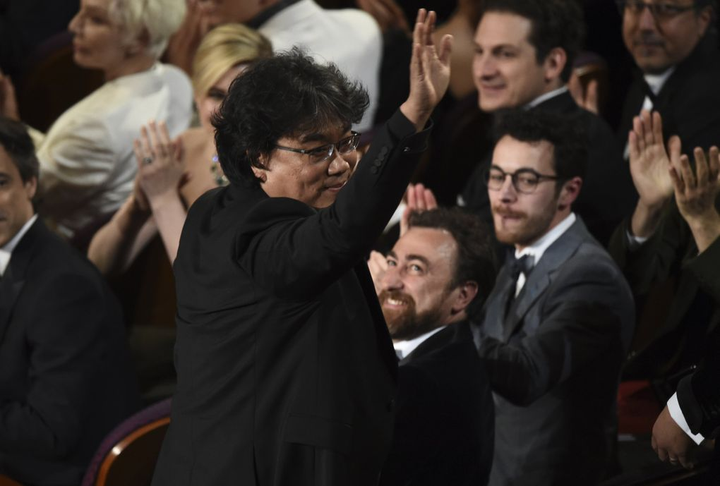 """Bong Joon-ho was seen in the audience before accepting the award for best original screenplay for """"Parasite"""" at the Oscars on Sunday, Feb. 9, 2020, at the Dolby Theatre in Los Angeles. (AP Photo/Chris Pizzello) CADC221 CADC221 (Chris Pizzello / Chris Pizzello/Invision/AP)"""