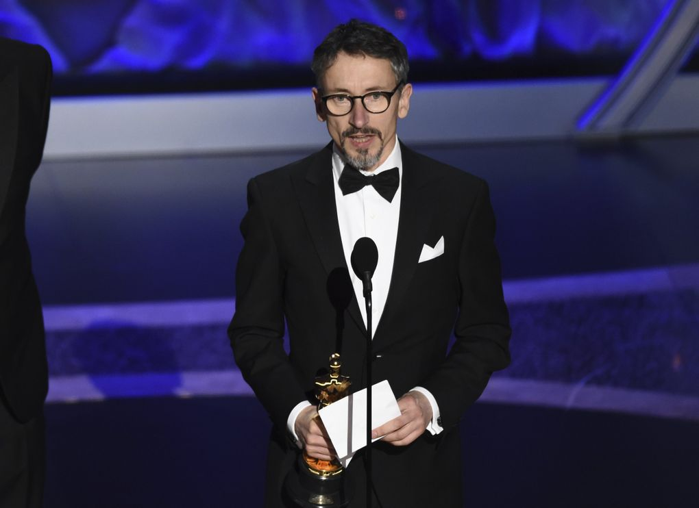 """Stuart Wilson accepts the award for best sound mixing for """"1917""""at the Oscars on Sunday, Feb. 9, 2020, at the Dolby Theatre in Los Angeles. (AP Photo/Chris Pizzello) CADC317 CADC317 (Chris Pizzello / Chris Pizzello/Invision/AP)"""