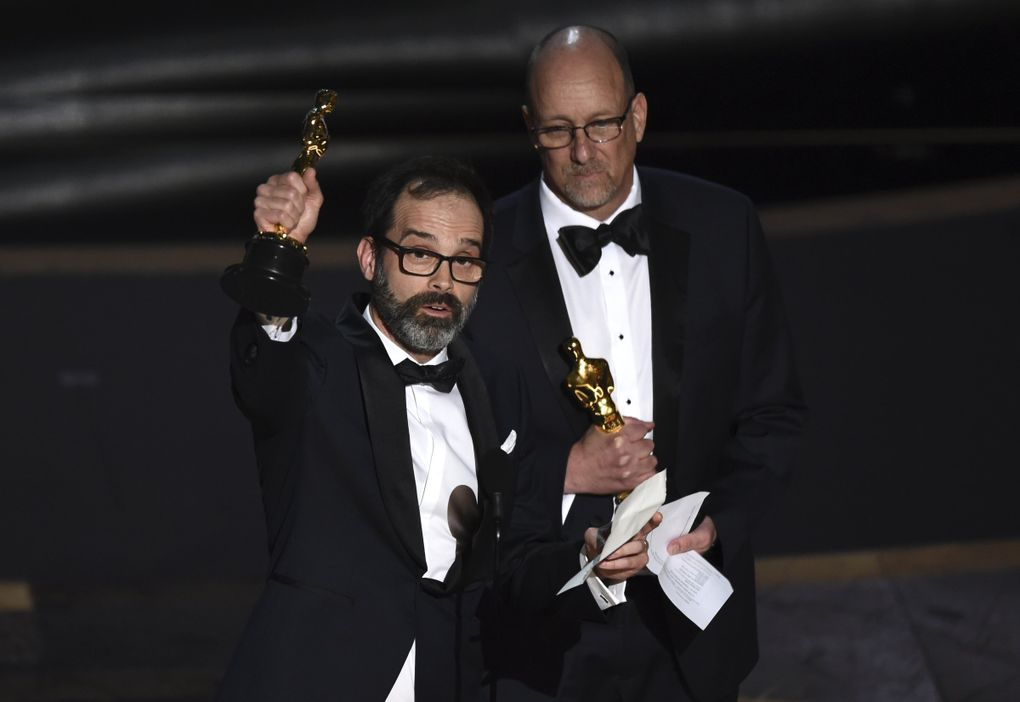 """Andrew Buckland, left, and Michael McCusker accept the award for best film editing for """"Ford v Ferrari"""" at the Oscars on Sunday, Feb. 9, 2020, at the Dolby Theatre in Los Angeles. (AP Photo/Chris Pizzello) CADC333 CADC333 (Chris Pizzello / Chris Pizzello/Invision/AP)"""