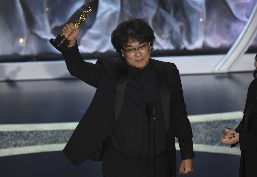 """Bong Joon Ho accepts the award for best international feature film for """"Parasite,"""" from South Korea, at the Oscars on Sunday, Feb. 9, 2020, at the Dolby Theatre in Los Angeles. (AP Photo/Chris Pizzello) CADC349 CADC349 (Chris Pizzello / Chris Pizzello/Invision/AP)"""