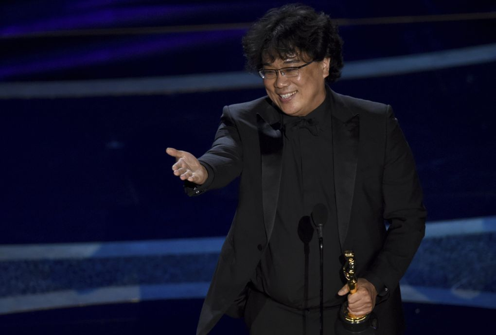 """Bong Joon Ho accepts the award for best director for """"Parasite"""" at the Oscars on Sunday, Feb. 9, 2020, at the Dolby Theatre in Los Angeles. (AP Photo/Chris Pizzello) CADC380 CADC380 (Chris Pizzello / Chris Pizzello/Invision/AP)"""