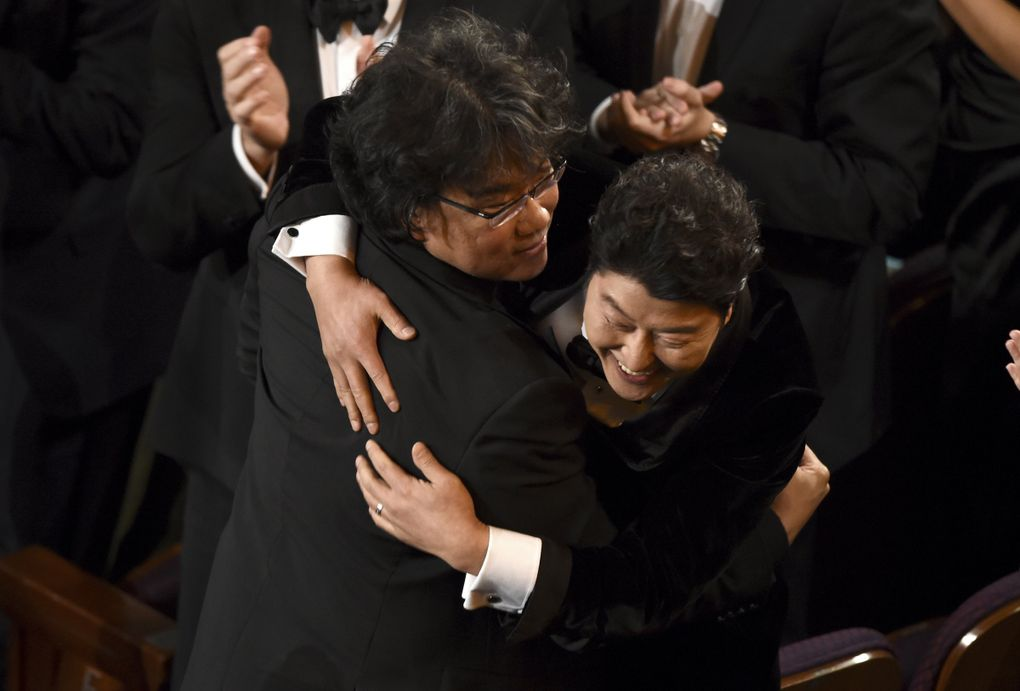 """Bong Joon Ho, left, and Kang-Ho Song celebrate before going on stage to accept the award for best picture for """"Parasite""""at the Oscars on Sunday, Feb. 9, 2020, at the Dolby Theatre in Los Angeles. (AP Photo/Chris Pizzello) CADC417 CADC417 (Chris Pizzello / Chris Pizzello/Invision/AP)"""