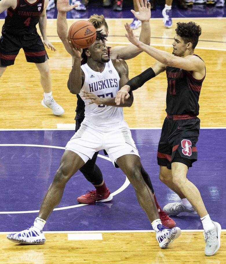 Washington Huskies forward Isaiah Stewart (33) falls back and to the ground as he passes the ball in a game against Stanford Cardinal on Thursday, Feb. 20, 2020 at Alaska Airlines Arena. (Amanda Snyder / The Seattle Times)