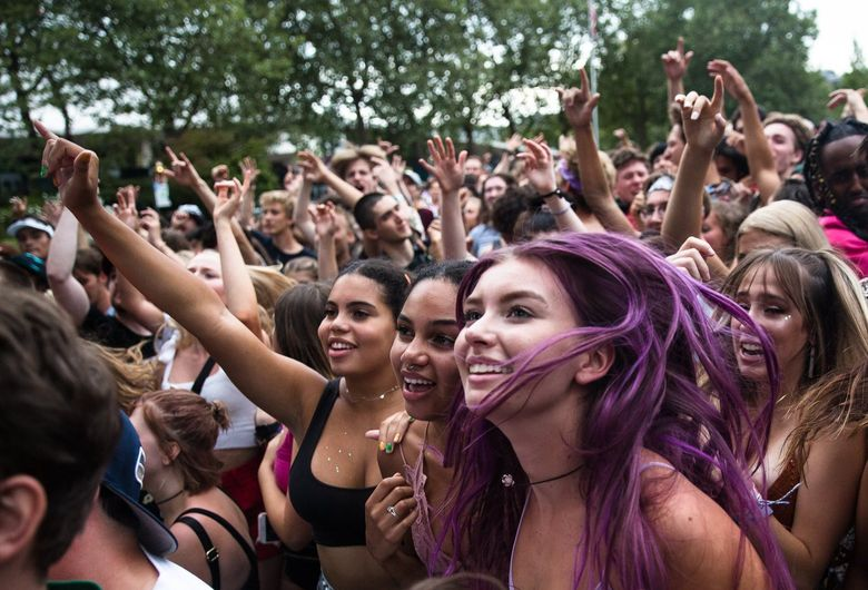 Sofia Green, Hailey Green, and Maddy Miller jump in the front row during Sol's performance on the first day of Bumbershoot 2019. (Rebekah Welch / The Seattle Times)