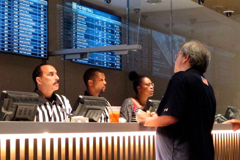 A gambler places sports bets at Bally's casino in Atlantic City, New Jersey. Washington is poised to become the 15th state to allow betting on sports, but the practice would be restricted to the state's tribal casinos. (Wayne Parry, The Associated Press, file)