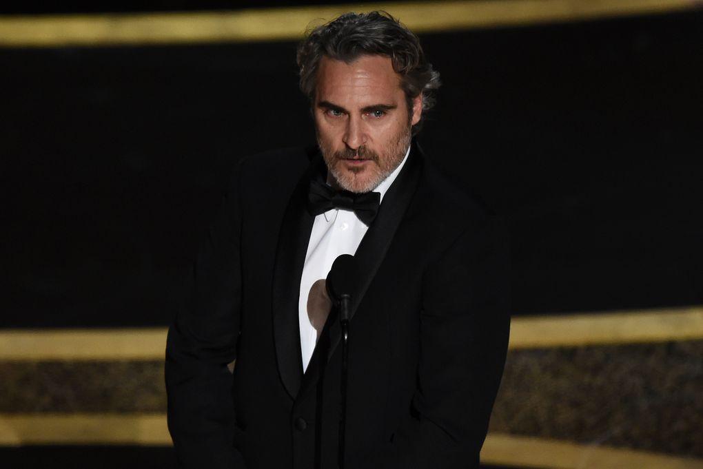 """Joaquin Phoenix accepts the award for best performance by an actor in a leading role for """"Joker"""" at the Oscars on Sunday, Feb. 9, 2020, at the Dolby Theatre in Los Angeles. (AP Photo/Chris Pizzello)"""
