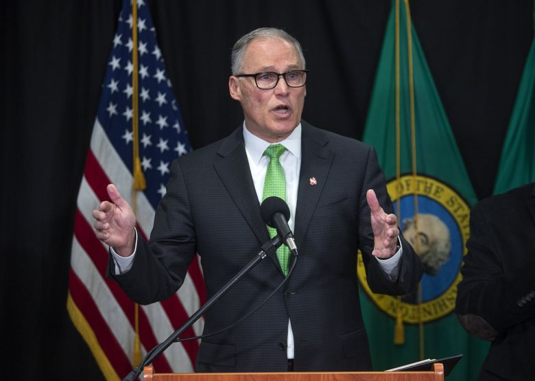 Gov. Jay Inslee at a press conference in Seattle on Wednesday. (Steve Ringman / The Seattle Times)