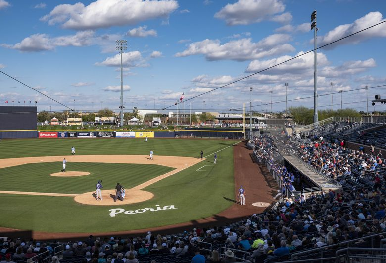 The Mariners opened Cactus League play with the Texas Rangers Sunday.  The Texas Rangers played the Seattle Mariners in Cactus League action Sunday, February 23, 2020 at the Peoria Sports Complex, Peoria, AZ. 213065 213065 (Dean Rutz / The Seattle Times)