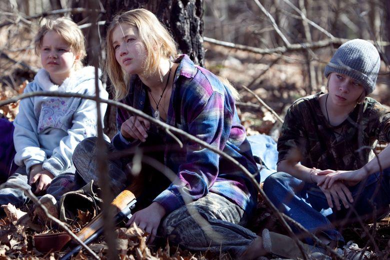 "From left: Ashlee Thompson, Jennifer Lawrence and Isaiah Stone  in ""Winter's Bone."" (Sebastian Mlynarski / The Associated Press)"