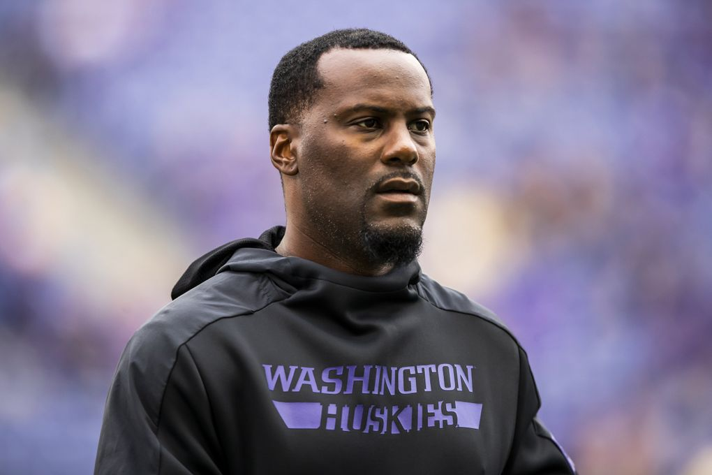 Wide receivers coach Junior Adams walks the field before the University of Washington Huskies take on the Hawaii Rainbow Warriors at Husky Stadium in Seattle Saturday September 14, 2019.  (Andy Bao / The Seattle Times)