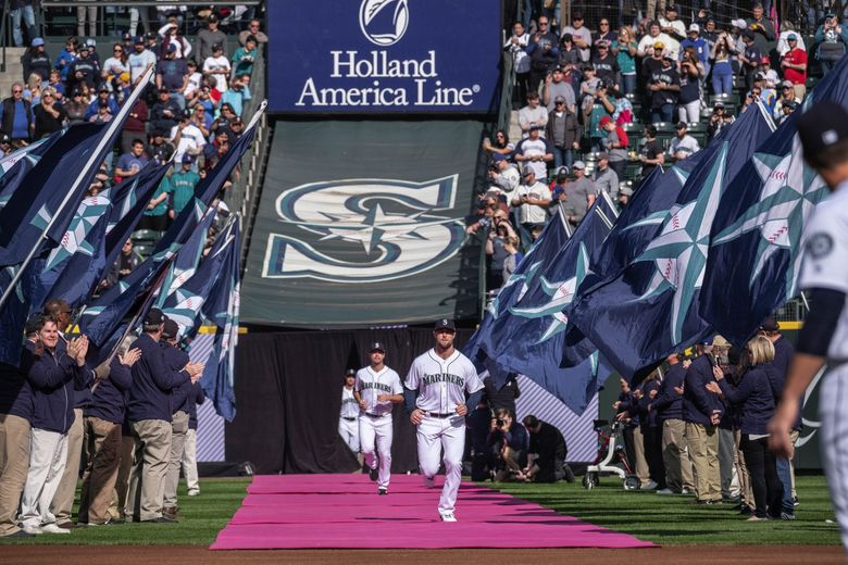 The Mariners come out for their home opener against the Boston Red Sox at T-Mobile Park on March 28, 2019.  (Dean Rutz / The Seattle Times)