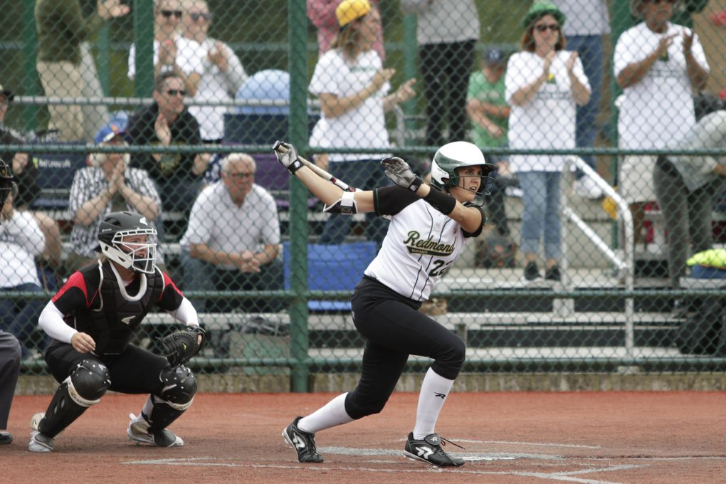 Redmond's Jennifer Cummings hits a double while playing in the third-place game at the Class 3A state tournament in 2018.  (Jason Redmond / The Seattle Times)