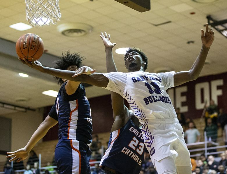 Garfield's Tari Eason goes up for a shot against Eastside Catholic and is fouled on Friday, Feb. 14, 2020 at Seattle Pacific. (Amanda Snyder / The Seattle Times)