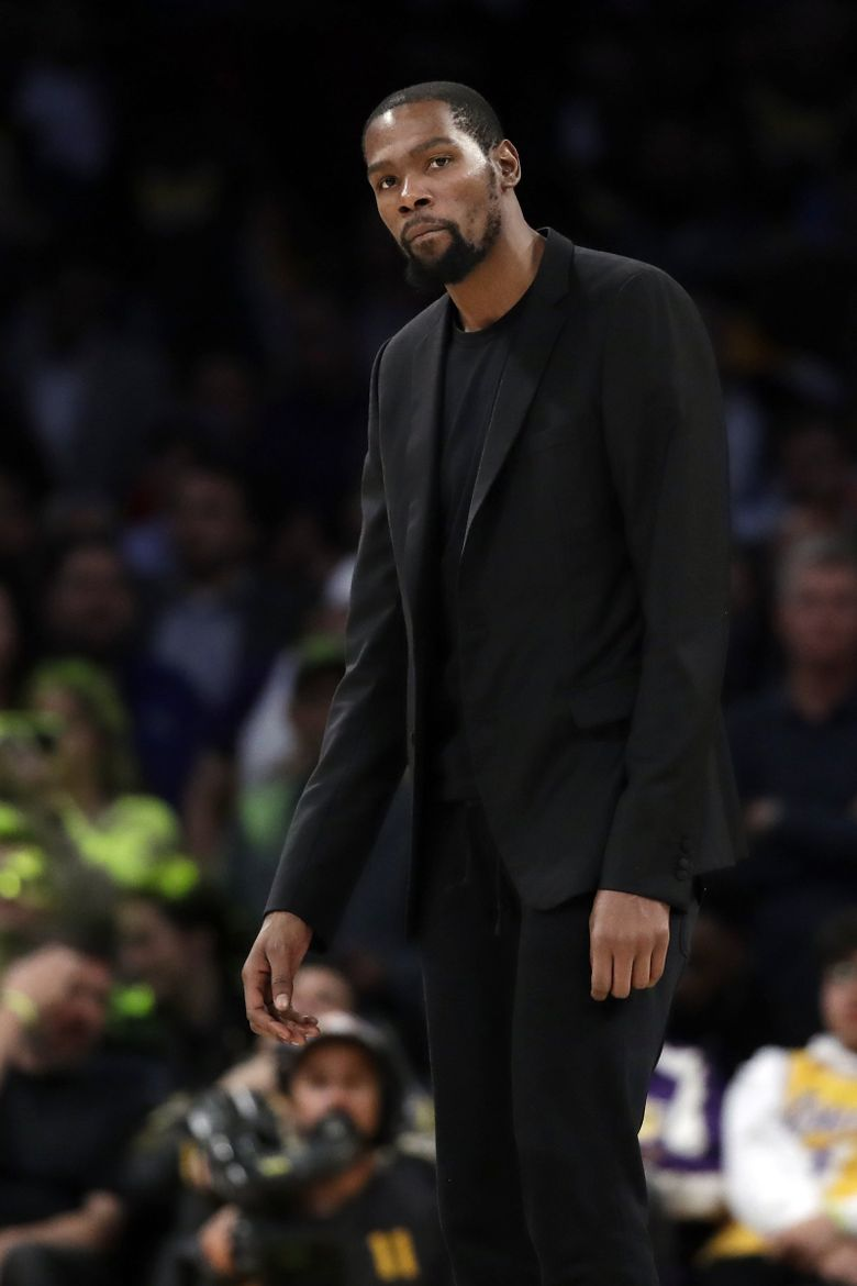 Brooklyn Nets' Kevin Durant looks on during the second half of an NBA basketball game against the Los Angeles Lakers Tuesday, March 10, 2020, in Los Angeles. (AP Photo/Marcio Jose Sanchez) LAS301 LAS301 (Marcio Jose Sanchez / The Associated Press)