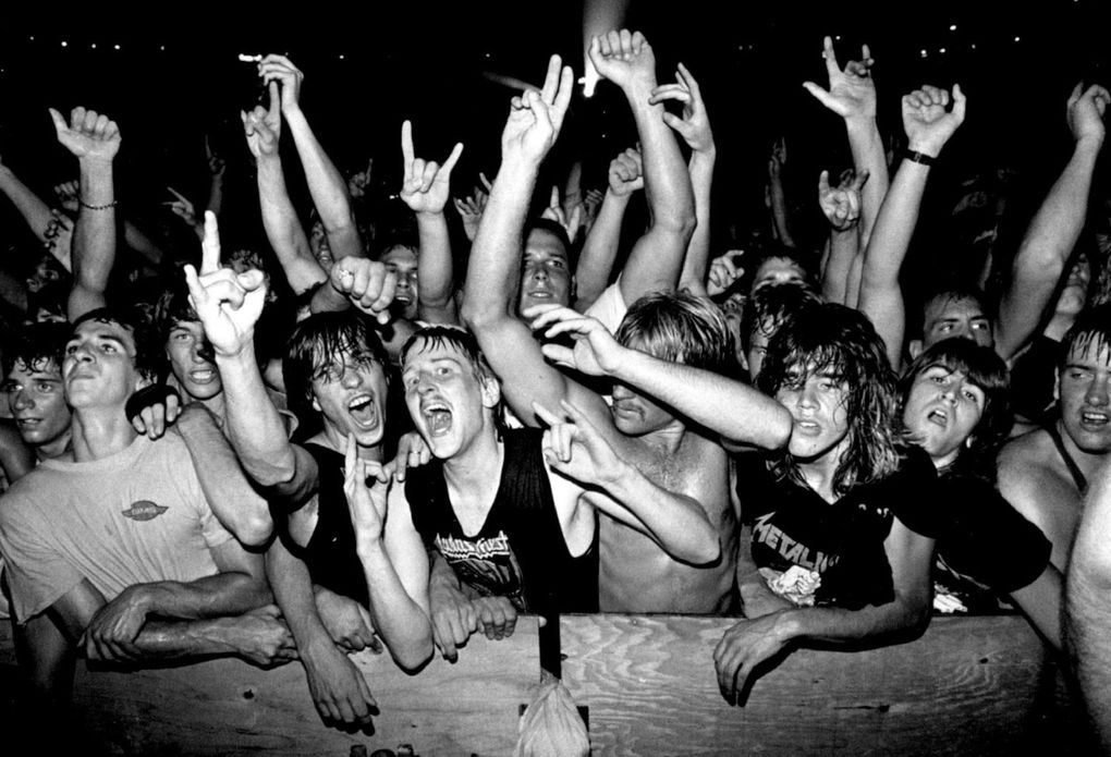 """Heavy metal fans at the """"Monsters of Rock"""" show in the Kingdome in 1988.  (Benjamin Benschneider / Seattle Times)"""