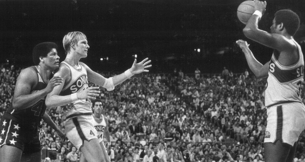 Sonics Paul Silas (with ball), Jack Sikma (41) and Dennis Johnson play an NBA Finals game in the Kingdome. (Jay Lurie / )