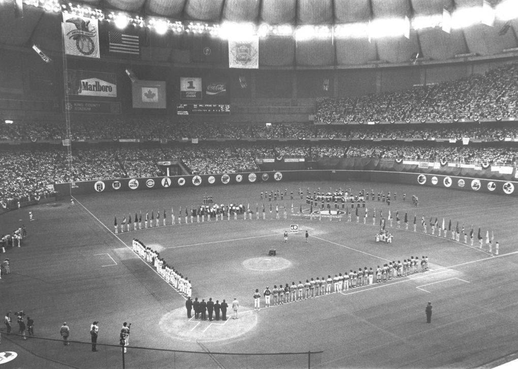 A capacity crowd of 58,906 stands for the singing of the Canadian and American National Anthems at the 1979 All-Star Game at the Kingdome in Seattle. (Cole Porter / The Seattle Times)